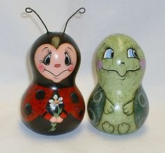 My ladybug and turtle are my original designs and painted on mini bottle gourds. They are 4 1/2 tall and 8 around. The ladybug has wire antennae.