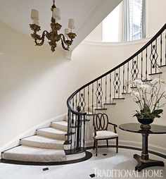 This home is filled with Old World details, like the railing on the graceful staircase. - Photo: Werner Straube / Design: Gail Plechaty