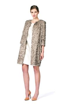 This PLAKINGER Debut Collection coat in handmade faux leather sequins is perfect for day and evening. The straight silhouette and the strong fabric surface create a modern, yet feminine look due to the soft beige color of the piece. byplakinger.com