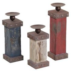 Three distressed wood candleholders.   Product:  Small, medium, and large candleholder    Construction Material: Wood and metal    Color: Red, blue, and white     Accommodates: (1) Candle each - not included Dimensions:  Small:  10.3 H x 4 W x 4 D  Medium: 12.5 H x 4 W x 4 D  Large: 14.5 H x 4 W x 4 D