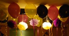 """Purple and yellow balloons and pom poms, with dark accents in keeping with the """"Friends"""" theme."""