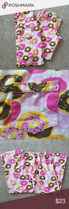 Victoria's Secret doughnut flannel pajama set Victoria's Secret donut/doughnut flannel pajama set. Both size XS. Top buttons up the front and had a pocket on the chest. Screenprinted tag is cracking on top, see last photo.  Pants have elastic at the waist and decorative button fly. Offers welcome. Victoria's Secret Intimates & Sleepwear Pajamas