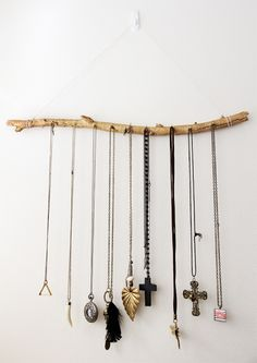 Tree branch hanging jewellery display.