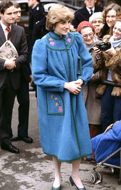 January 1, 1982 Princess Diana met with locals in Brixton, a borough of South London, while wearing an embroidered wool coat.