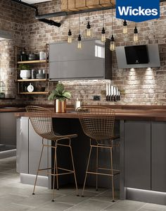 Minimalist design - maximum impact. The deep grey of the high gloss cabinets with clean lines provides a great base for a modern industrial feel without the grit. The use of copper and earth tones in the solid wood of the worktops and accessories brings warmth to this space.