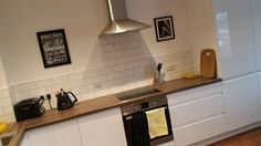 Whitby Harbour Kitchen. Modern white Scandinavian kitchen by Stringers of Whitby
