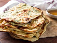 A popular Moroccan flatbread, msemen (or m'smen) is made by folding the dough over itself to make layer upon flaky layer. This version is flavored with fresh mint and dipped into honey-butter.