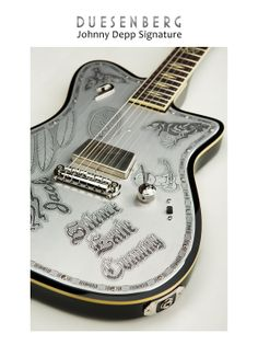 The Deusenberg Johnny Depp Signature guitar created over a year's time working with Johnny Depp on the design.  The front and back of the guitar feature images of some of Johnny's tattoos.  Only 52 hand-signed guitars available worldwide.