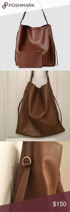 """All Saints North South Tote All Saints large leather tote, perfect for work/everyday. Includes a pouch and interior pocket. Missing thread on one corner of the label (can be resewn). Dust bag included. Measurements: 13.5x14x5.5"""" All Saints Bags Totes"""