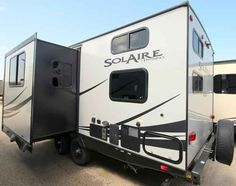 2016 New Forest River SOLAIRE ULTRA-LITE 239DSBH Travel Trailer in Texas TX.Recreational Vehicle, rv, 2016 Forest River SOLAIRE ULTRA-LITE239DSBH, 32in Exterior TV, Black tank flush, RVQ Grill, Spare Tire Carrier, Texas Edition, TOYLOCK, Ultra Value Package, New Forest, Forest River, Rv Campers, Camper Van, Rv Accessories, Black Tank, Recreational Vehicles, Texas, Exterior