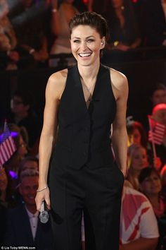 Chic: The presenter wore her hair slicked back and completed her elegant look with sky-hig...