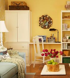 A great way to break up a wall of shelves and cabinets is to incorporate a small desk area.  BHG recommends keeping everything the same colour in order to give a built-in appearance.