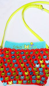 This purse was designed by a Facebook friend, Maria Luna. It can be made with a single-hole aluminum pop tabs such as Monster, Redbull, Budweiser, etc. Visit her page and make sure to like it. She has lots of cute crochet items. Hope you like the tutorial.