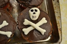 Skull and crossbones cupcake. Marshmallow fondant shaped into skull and bones, black food marker used to darken eye sockets and nose