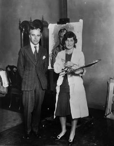 With British artist the Marchioness of Queensbury, New York, Feb. 1927. Her portrait of him is in the background.
