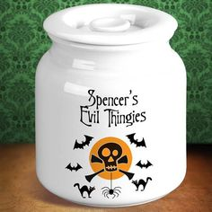 Personalized Halloween Skull Cookie Jars. The Personalized Halloween Skull Cookie Jar keeps your cookies out of sight from those pesky kids! With a capacity of over 1 gallon, this Halloween cookie jar has enough room to hold treats for the whole family. Your cookies will stay fresh because of the air tight seal, and your kids will love the skull design that enhances the 2 lines of personalization. This jar is microwave and oven safe.