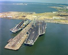 HMS ARK ROYAL tied up at Norfolk Naval Station's Pier 14 next to USS NIMITZ in August 1978