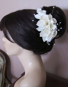 Hey, I found this really awesome Etsy listing at http://www.etsy.com/listing/77541609/ivory-satin-and-pearls-calla-lilies-hair possible hair acessorie for the girls