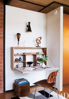 An Ellwood-Lomax drop-front desk in the living room | archdigest.com