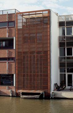 Custom Sun Control by Hunter Douglas. CorTen Steel perforated folding panels and cladding system. #façade #hunterdouglas #architecture