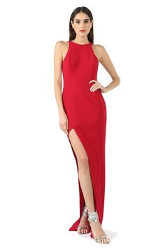 FORD ASYMMETRIC HIGH SLIT GOWN  $495  SHOW SOME LEG WITH THE DRAMATIC ASYMMETRIC HIGH SLIT GOWN. SLEEVELESS, FULLY LINED STYLE FEATURES A HIGH LOW LOOK WITH V BACK, HIDDEN ZIPPER AND HOOK AND EYE CLOSURE.   92% POLYESTER 8% POLYURETHANE DRY CLEAN ONLY