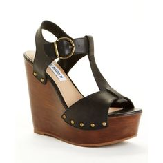 Steve Madden Women's Wyliee T-Strap Sandals Step into the perfect foundation for spring and summer looks in the Wyliee sandal from Steve Madden Women's. The soft leather upper sports an open toe and t-strap styling with an adjustable ankle buckle for an ideal fit. Burnished stud accents and a daringly high wedge and platform complete the look, impeccable with slim denim or a flirty dress. Top part of sole is lifting a little bit but definitely still wearable and comfortable. Steve Madden…