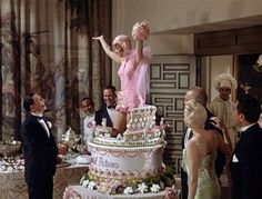 """""""all I do is dream of you"""".Gene Kelly and Debbie Reynolds portray the characters of Don Lockwood and Kathy Selden respectively in the movie """"Singin' in the Rain"""". Old Movies, Great Movies, Vintage Movies, Gene Kelly Dancing, Rain Cake, Rain Costume, Movie Cakes, Sherlock Fandom, Sherlock Holmes"""