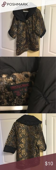 30% off bundles Leopard Faux Fur Coat Faux Fur leopard coat. Has sequins. Never worn. Zip closure. Size 6. Will fit an 8. No rips or stains. simon chang Jackets & Coats