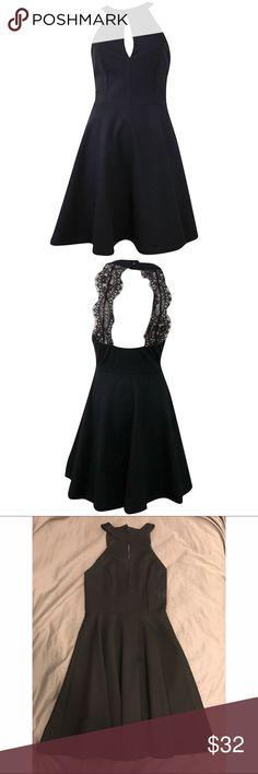 Black Keyhole Lace Back, Fit & Flare Dress •Black fit and flare dress •Open lace back •New with tags •65% Rayon, 30% Nylon, and 5% Spandex  http://pitaya.myshopify.com/collections/dresses/products/keyhole-bust-lace-back-flare-dress-black?variant=32783124740 Pitaya Dresses Mini