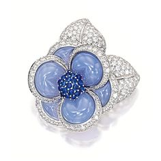 BLUE CHALCEDONY, SAPPHIRE AND DIAMOND 'BLUE GARDENIA' BROOCH, VAN CLEEF & ARPELS. Modelled as a flower, set with carved blue chalcedony, highlighted by pistils set with cabochon sapphires, leaves set with brilliant-cut diamonds together weighing approximately 4.80 carats, mounted in 18 karat white gold, signed and numbered MU 0387.