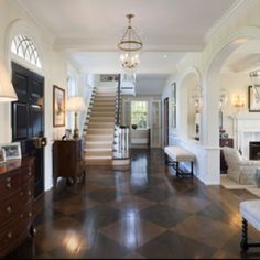 Lovely  Love these floors!!!/ @ Entry and mud porches, into basement area