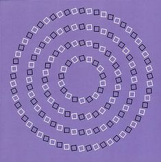 Check out the spiral...except it is not a spiral, just circles.  Don't believe me? Use your finger to follow the fake spiral.  The tilt of the boxes fools your brain into believing it is a spiral.