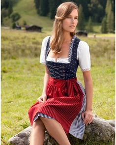 Love the easy-to-wear palette of red, white and navy blue at work here. #dirndl #dress #folk #costume #German #clothing