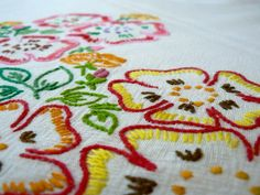 1950s colourful hand embroidered floral table cloth. $36.00, via Etsy.