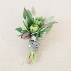 Flowers used in the boutonnière:  Hellebores  Rosemary  Lavender  Green Ranunculus