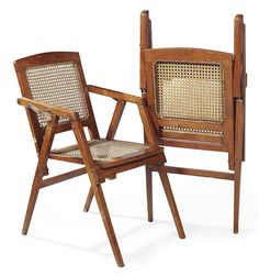 A PAIR OF PIERRE JEANNERET TEAK AND CANEWORK FOLDING CHAIRS CIRCA 1952-56 canework seat and back 34 in. (86.5 cm.) high; 19¾ in. (50 cm.) wide; 26 in. (66 cm.) deep