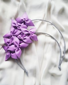 By Silpa Parmar  | Lilac leather flowers on a silver halo #millinery #hatacademy