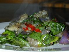 Stir fried eggplant with basil and chili pepper.