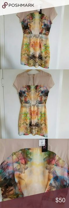 "*2X HP* NWT LF Neon Rainbow Buddha Floral Dress New w/ tags. Funky neon rainbow colored dress with sheer nude fabric top. Tropical flowers & subtle Buddha in the print. Pleating in front of bust for enhancement. Concealed back zip. 100% Polyester. Retailed for $168 at LF. By You.   *Sz M Aus which = US S. Approx measurements: length= 32"" shoulder to hem, 13.5"" waist, 17"" bust* LF Dresses Mini"