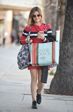 Lady in red: Lucy Hale stunned ina scarlet minidress as she indulged in a spot of shopping in Los Angeles on Wednesday