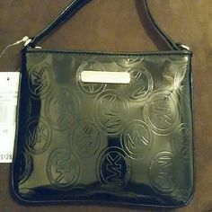 """Brand new michael Kors small crossbody leather bag MK circle monogram me roses glossy black leather exterior. MK logo plate on front. Gold tone hardware. Top zip closure with signature metal pull. Buckle adjustable leather shoulder/crossbody strap approx. 22.5"""" drop at middle hole (5holes).... Michael Kors Bags Crossbody Bags"""