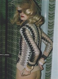 outfit: Cacharel, bracelets: Fabrice, glasses: Lafont. Marie Claire, March 1973. Photographed by Helmut Newton.