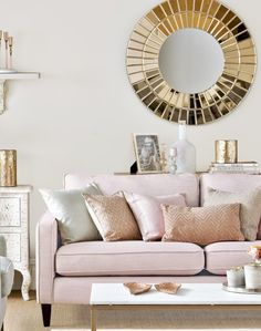 Looking for living room ideas? Be inspired by this neutral living room with rose gold and pink accents. Find more room design and decorating ideas at theroomedit.com