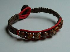 RED LEATHER BEADED BRACELET #B-378 7 inch long red leather bracelet with painted wood beads and brown hemp cord. Button and loop closure. Price: $7.00