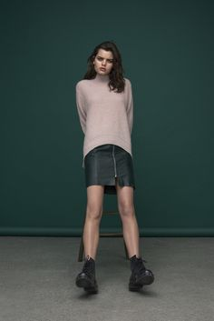 Green leather shirt with zip detailing and soft pink knitted turtlemeck.  Knit: Verdi / Ventura Leather Skirt : Vidrik / Venice