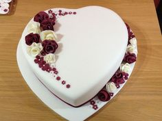 Wedding Cake Design Ideas | Covered In White Cream Heart Shaped Wedding Cake With White And Red Roses