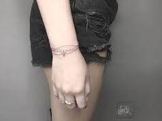 Image result for cool bracelet tattoos for girls