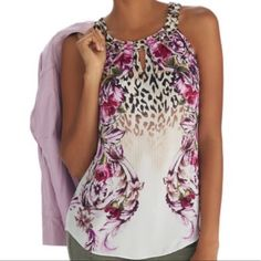 NWT!! WHBM Floral top😻 Beautiful WHBM top! A mix pattern of pink floral and leopard on cream. Fabric is silk and NWT! This top is sold out. I'm ONLY selling because I just never got around to exchanging for a different size. The top is flawless and you will love!! Looks way better on a body than my hunched back mannequin! Lol..Thanks for looking!! White House Black Market Tops