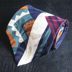 Oscar de la Renta Couture Collection silk tie in a geometric design. Great gift!    Maker: Oscar de la Renta  Fabric: Silk  Width: 4 inches