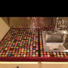 Bottle cap counter. 1. Place the bottle caps down. 2. Pour epoxy on top. 3. To remove bubbles on epoxy exhale on surface(carbon monoxide removes air bubbles). 4. Let dry according to directions on epoxy container.